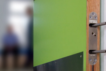 Free swing door closers at new mental health hospital