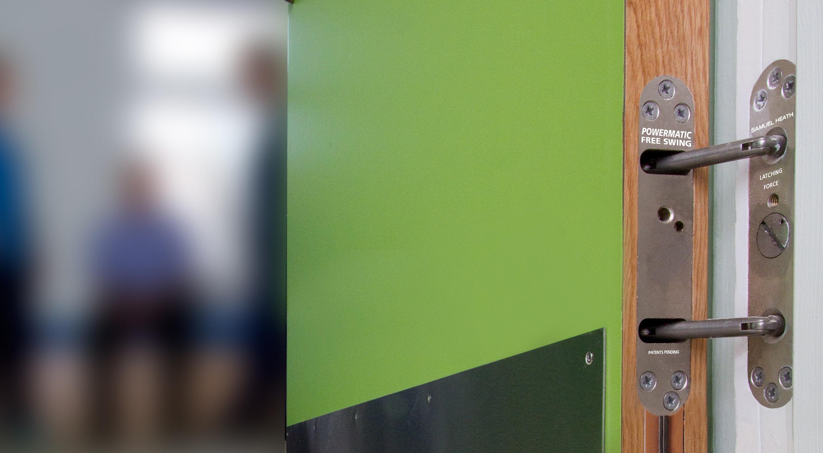 Free swing door closers at new mental health hospital