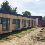 SIG Roofing celebrates 'Homes for the Homeless' completion