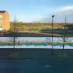 Masterpiece created by local residents on the hoarding at Orchard Park, Cambridge