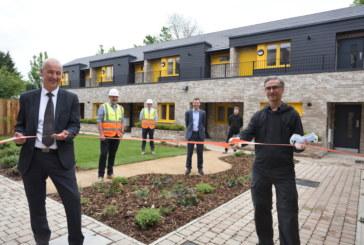 Ribbon cutting marks handover of council homes at Akeman Street