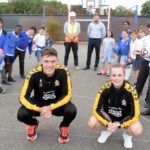 Local school children challenge Cambridge United players to keepy uppies